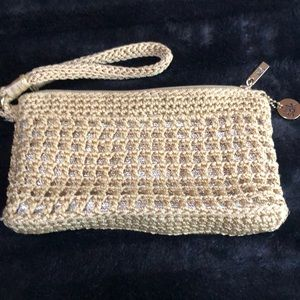 The Sak crochet gold color clutch wristlet